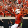 Oklahoma State\'s Jeremy Smith (31) celebrates a touchdown during a college football game between Oklahoma State University (OSU) and Savannah State University at Boone Pickens Stadium in Stillwater, Okla., Saturday, Sept. 1, 2012. Photo by Sarah Phipps, The Oklahoman