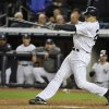 New York Yankees\' Raul Ibanez follows through on a home run in the 12th inning in Game 3 of the Yankees\' American League division baseball series against the Baltimore Orioles on Wednesday, Oct. 10, 2012, in New York. The Yankees won 3-2. (AP Photo/Bill Kostroun)