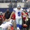 Photo - Dallas Cowboys punter Chris Jones (6) holds as quarterback Josh Freeman (5) kicks a field goal against the Tampa Bay Buccaneers during the second half of an NFL football game on Sunday, Sept. 23, 2012, in Arlington, Texas. (AP Photo/Tim Sharp)