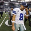 Photo - Dallas Cowboys quarterback Tony Romo (9) leaves the field after overtime play of an NFL football game against the New Orleans Saints, Sunday, Dec. 23, 2012 in Arlington, Texas. The Saints won 34-31. (AP Photo/Sharon Ellman)  ORG XMIT: CBS143