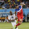 United States\' goalkeeper Tim Howard grabs the ball as he makes a save at the feet of his teammate Geoff Cameron, right, and Ghana\'s Andre Ayew during the group G World Cup soccer match between Ghana and the United States at the Arena das Dunas in Natal, Brazil, Monday, June 16, 2014. (AP Photo/Dolores Ochoa)