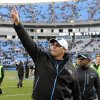 Photo - Carolina Panthers coach Ron Rivera acknowledges fans as he walks off the field after the Panthers defeated the Oakland Raiders 17-6 in an NFL football game in Charlotte, N.C., Sunday, Dec. 23, 2012. (AP Photo/Mike McCarn)