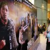 In this photo taken Wednesday, Feb. 13, 2013, a woman looks at an advertisement for the U.S. film