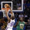 Oklahoma City\'s Kevin Durant (35) shoots in Boston\'s Brandon Bass (30) during the NBA game between the Oklahoma City Thunder and the Boston Celtics at the Chesapeake Energy Arena in Oklahoma City, Sunday, March 10, 2013. Photo by Sarah Phipps, The Oklahoman