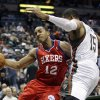 Philadelphia 76ers\' Evan Turner tries to drive past Milwaukee Bucks\' Tobias Harris (15) during the first half of an NBA basketball game, Wednesday, April 25, 2012, in Milwaukee. (AP Photo/Morry Gash)