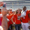 Micah Olson, 15, gets her picture taken with Oklahoma State\'s Justin Gilber after OSU\'s spring football game at Boone Pickens Stadium in Stillwater, Okla., Sat., April 20, 2013. Photo by Bryan Terry, The Oklahoman