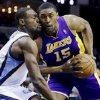 Los Angeles Lakers\' Metta World Peace (15) is fouled by Memphis Grizzlies\' Tony Allen during the first half of an NBA basketball game in Memphis, Tenn., Wednesday, Jan. 23, 2013. (AP Photo/Daniel Johnston)