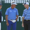 Photo - Tom Watson of the US, left, Darren Clarke of Northern Ireland and Jim Furyk of the US, right, talk on the 1st tee box during the first day of the British Open Golf championship at the Royal Liverpool golf club, Hoylake, England, Thursday July 17, 2014. (AP Photo/Jon Super)