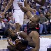 Photo - CORRECTS DATE - Charlotte Bobcats  forward Michael Kidd-Gilchrist, left, and Toronto Raptors forward Chuck Hayes battle for a loose ball in the first half of an NBA basketball game Monday, Jan. 20, 2014 in Charlotte, N.C. (AP Photo/Nell Redmond)