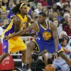 Golden State Warriors\' Festus Ezeli, right, looks to drive around Los Angeles Lakers\' Jordan Hill in the first half of a preseason NBA basketball game in Fresno, Calif., Sunday, Oct. 7, 2012. (AP Photo/Gary Kazanjian)