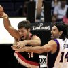 Portland Trail Blazers\' Joel Freeland (19), of England, gets a pass off as Phoenix Suns\' Luis Scola (14), of Argentina, defends during the first half of an NBA preseason basketball game Friday, Oct. 12, 2012, in Phoenix. (AP Photo/Ross D. Franklin)