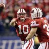 Wisconsin quarterback Curt Phillips (10) throws a pass to Derek Watt during the first half of the Big Ten championship NCAA college football game against Nebraska on Saturday, Dec. 1, 2012, in Indianapolis. (AP Photo/AJ Mast)