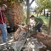 Jess Burrow, left, and James Patterson, look over the damage caused outside the home of Joe and Mary Reneau when their chimney was toppled by Saturday\'s earthquake, in Sparks, Okla., Sunday, Nov. 6, 2011. (AP Photo/Sue Ogrocki) ORG XMIT: OKSO108