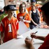 Travis Fink, 11 of Oklahoma City, has a miniature helmet signed by Oklahoma State head coach Mike Gundy at fan appreciation day at Gallagher-Iba Arena in Stillwater on August 3, 2013. KT King, For The Oklahoman