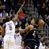 Phoenix Suns\' Michael Beasley (0) has his shot blocked by Oklahoma City Thunder\'s Kendrick Perkins, center, as Serge Ibaka (9), of the Congo, comes in to defend during the first half in an NBA basketball game, Sunday, Feb. 10, 2013, in Phoenix. (AP Photo/Ross D. Franklin)