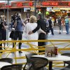 Ames, Iowa residents Nancy Levindowski and Steve Keller have their photo taken and video shot after exchanging wedding vows at the Denny\'s restaurant on Fremont Street in Las Vegas, Wednesday, April 4, 2013. (AP Photo/Las Vegas Sun, Sam Morris)