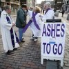 Jim Alberty receives ashes from Rev. Shirley Bowen on a sidewalk in downtown Portland, Maine, on Ash Wednesday, Feb. 22, 2012. Rev. Tim Higgins, left, and Rev. Peter Bowen look on.