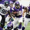 Photo -   Minnesota Vikings running back Adrian Peterson rushes away from Jacksonville Jaguars defensive tackle C.J. Mosley (99) and defensive end Tyson Alualu (93) during overtime of an NFL football game, Sunday, Sept. 9, 2012, in Minneapolis. The Vikings won 26-23. (AP Photo/Genevieve Ross)