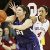 Kansas State\'s Ashlynn Knoll (21) passes away from Oklahoma\'s Nicole Griffin (4) in the first half during an NCAA women\'s basketball game between the Oklahoma Sooners (OU) and the Kansas State Wildcats at Lloyd Noble Center in Norman, Okla., Saturday, Jan. 11, 2014. Photo by Nate Billings, The Oklahoman