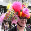 Wearing a hat made with plastic puppet eyes, Leslie Lowe, of New York, poses for photographs as she takes part in the Easter Parade along New York\'s Fifth Avenue Sunday, April 24, 2011. (AP Photo/Tina Fineberg)