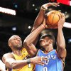 OKC's Serge Ibaka has his shot smothered by the Lakers' Lamar Odom during the Thunder's 95-92 loss on Tuesday night. AP photo