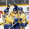 Photo - Nashville Predators forward David Legwand (11) celebrates with Nick Spaling (13) and Craig Smith (15) after Legwand scored against the San Jose Sharks in the second period of an NHL hockey game Tuesday, Jan. 7, 2014, in Nashville, Tenn. (AP Photo/Mark Humphrey)