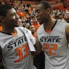 Photo - Oklahoma State senior guard Markel Brown, right, talks teammate Marcus Smart after an NCAA college basketball game in Stillwater, Okla., Monday, March 3, 2014. Oklahoma State won 77-61. (AP Photo/The Oklahoman, KT King)