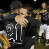 Kirby Kunka, facing camera, hugs Tyler Morse of Verdigris after winning the class 3A state baseball tournament championship game between Eufaula and Verdigris at Edmond Santa Fe, Saturday, May14, 2011. Photo by Bryan Terry, The Oklahoman