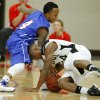 Hugo\'s Trey Johnson, at right, tries to gain control of the ball beside Millwood\'s Jaylen Edwards during a Class 3A boys state basketball tournament game between Hugo and Millwood at Yukon High School in Yukon, Okla., Thursday, March 7, 2013. Photo by Bryan Terry, The Oklahoman