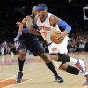 Photo - New York Knicks' Carmelo Anthony, right, drives by Charlotte Bobcats' Anthony Tolliver during the second quarter of an NBA basketball game, Friday, Jan. 24, 2014, at Madison Square Garden in New York. (AP Photo/Bill Kostroun)
