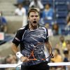 Photo - Stan Wawrinka, of Switzerland, reacts after defeating Thomaz Bellucci, of Brazil, 6-3, 6-4, 3-6, 7-6 (1) during the second round of the U.S. Open tennis tournament early Thursday, Aug. 28, 2014, in New York. (AP Photo/Jason DeCrow)