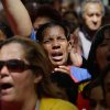 Women react as they gather at Simon Bolivar square in support of Venezuela\'s President Hugo Chavez in Caracas, Venezuela, Sunday Dec. 9, 2012. Chavez is to return to Cuba Sunday for another surgery in his battle against cancer, which has led him to speak publicly of a successor for the first time. Chavez said Saturday that if there are