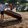 Photo -  Riley Choquette stands by the Javelin I before taking part in his sixth Cardboard Boat Regatta as part of the LibertyFest events at Arcadia Lake. PHOTO BY BRYAN TERRY, THE OKLAHOMAN   Bryan Terry -  THE OKLAHOMAN