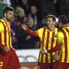 Photo - Barcelona's Gerard Pique, left, is congratulated by teammate Alexis Sanchez from Chile, and Lionel Messi from Argentina,  after  Pique scored a goal against  Levante during their La Liga soccer match at the Ciutat de Valencia stadium in Valencia, Spain, Sunday, Jan. 19, 2014. (AP Photo/Alberto Saiz)