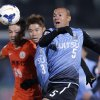 Photo - Kawasaki Frontale's Jeci, right, Yusuke Tanaka, center, and Guizhou Renhe's Chen Zijie vie for the ball during their group stage soccer match of AFC Champions League  in Kawasaki, near Tokyo, Wednesday, Feb. 26, 2014. (AP Photo/Shuji Kajiyama)