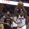 Photo - Cleveland Cavaliers' Dion Waiters (3) drives past Toronto Raptors' John Salmons (25) during the second quarter of an NBA basketball game Tuesday, March 25, 2014, in Cleveland. (AP Photo/Tony Dejak)