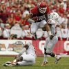 OU\'s Trey Millard (33) leaps over UT\'s Mykkele Thompson (2) and pushes away Adrian Phillips (17) in the second quarter during the Red River Rivalry college football game between the University of Oklahoma (OU) and the University of Texas (UT) at the Cotton Bowl in Dallas, Saturday, Oct. 13, 2012. OU won, 63-21. Photo by Nate Billings, The Oklahoman