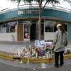 A passerby pays his respects at a makeshift memorial in front of the IV Deli Mart, Sunday, May 25, 2014, the scene of a drive-by shooting Friday in the Isla Vista area near Goleta, Calif. Calif. Sheriff\'s officials said Elliot Rodger, 22, went on a rampage near the University of California, Santa Barbara, stabbing three people to death at his apartment before shooting and killing three more in a crime spree through a nearby neighborhood. (AP Photo/Chris Carlson)