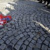 Photo -   A burned Croatian flag seen in front of a police cordon during the protest in front of the presidency building in Belgrade, Serbia, Saturday, Nov. 17, 2012. A few hundred hardline Serbian nationalists burned a Croatian flag angry that a U.N. war crimes court has overturned the convictions of two Croatian generals for murdering and expelling Serbs in a 1995 offensive. Serbia is furious that the appeals judges at the Hague court on Friday freed generals Ante Gotovina and Mladen Markac, who previously had been sentenced to lengthy prison terms for crimes against Serbs. (AP Photo/Darko Vojinovic)
