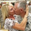 Wendy Davis kisses husband Danny as he and fellow soldiers from the 1-245th Airfield Operations Battalion return home on Tuesday, August 16, 2011, in Norman, Okla. after spending eight months in Afghanistan. Photo by Steve Sisney, The Oklahoman