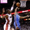 Oklahoma City\'s Russell Westbrook (0) goes to the basket past Miami\'s Chris Bosh (1) during Game 4 of the NBA Finals between the Oklahoma City Thunder and the Miami Heat at American Airlines Arena, Tuesday, June 19, 2012. Photo by Bryan Terry, The Oklahoman