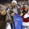 Baseball great Matt Kemp receives a Thunder jersey in the first half as the Oklahoma City Thunder play the Orlando Magic in NBA basketball at the Chesapeake Energy Arena on Sunday, Dec. 25, 2011, in Oklahoma City, Okla. Photo by Steve Sisney, The Oklahoman