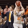 OSU\'s Keiton Page (12) shoots a 3-point shot in front of coach Travis Ford in the second half of a men\'s college basketball game between the Oklahoma State University Cowboys and the University of Kansas Jayhawks at Gallagher-Iba Arena in Stillwater, Okla., Monday, Feb. 27, 2012. KU won, 70-58. Photo by Nate Billings, The Oklahoman