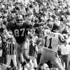 "Photo - This Sept. 10, 1978, photo provided by the NFL shows Atlanta Falcons defensive end Claude Humphrey moving in on Los Angeles Rams quarterback Patrick Haden during a football game in Los Angeles. Humphrey wishes he could have made the Pro Football Hall of Fame ""a long time ago where I could have actually enjoyed it more."" (AP Photo/NFL Photos)"