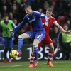 Photo - Southampton's Steven Davis, right, competes with Chelsea's Fernando Torres during their English Premier League soccer match at St Mary's stadium, Southampton, England, Wednesday, Jan. 1, 2014. (AP Photo/Sang Tan)