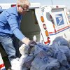 Michael Higginbottom unloads food from a mail truck as he helps volunteers sort food during the Stamp Out Hunger food drive at the Britton Post Office in northwest Oklahoma City on May 14, 2010. Every year, letter carriers collect nonperishable food donations from households on their route to benefit the Regional Food Bank of Oklahoma. OKLAHOMAN ARCHIVE PHOTO