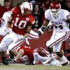 Oklahoma\'s Frank Alexander (84) goes after a fumble by Nebraska\'s Roy Helu Jr. (10) during the first half of the college football game between the University of Oklahoma Sooners (OU) and the University of Nebraska Cornhuskers (NU) on Saturday, Nov. 7, 2009, in Lincoln, Neb. Photo by Chris Landsberger, The Oklahoman
