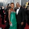 Viola Davis, left, and Julius Tennon arrive before the 84th Academy Awards on Sunday, Feb. 26, 2012, in the Hollywood section of Los Angeles. (AP Photo/Matt Sayles) ORG XMIT: OSC147