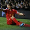 Photo - Liverpool's Luis Suarez celebrates after scoring a goal during the English Premier League soccer match between Tottenham Hotspur and Liverpool at the White Hart Lane stadium in London Sunday, Dec. 15, 2013. (AP Photo/Alastair Grant)