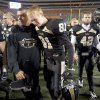 Broken Arrow's Calum Holmes, center, walks off the field with teammates after the Tigers lost to Tulsa Union in the Class 6A state championship game on Dec. 1. PHOTO BY JEFF LAUTENBERGER, Tulsa World